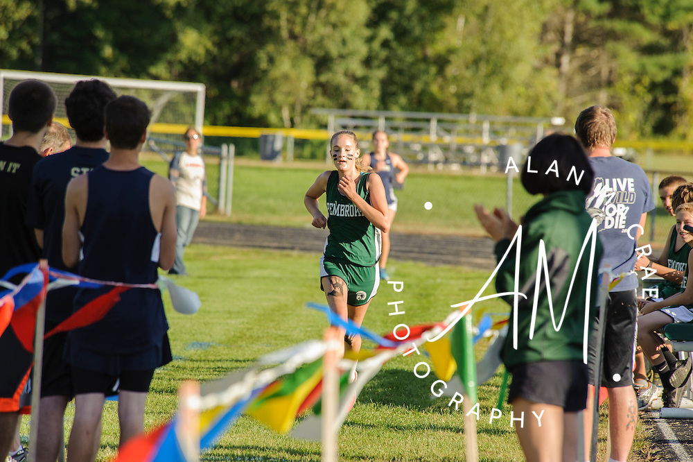 Pembroke sophomore Allison Fischer crosses the finish line in yesterday's cross country event at Pembroke Academy.  (Alan MacRae/for the Monitor)