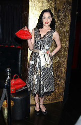 DITA VON TEESE at a preview of Lulu Guinness's new Handbag Collection ' Couture' held at Aviva, Baglioni Hotel, 60 Hyde Park Gate, London SW7 on 15th February 2006.<br /><br />NON EXCLUSIVE - WORLD RIGHTS