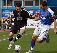 Carlisle's Peter Murphy and Swansea's Leon Britton.