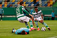 Paulinho and Jovane Cabral quickly grab the ball for another chance during the Liga NOS match between Sporting Lisbon and Belenenses SAD at Estadio Jose Alvalade, Lisbon, Portugal on 21 April 2021.