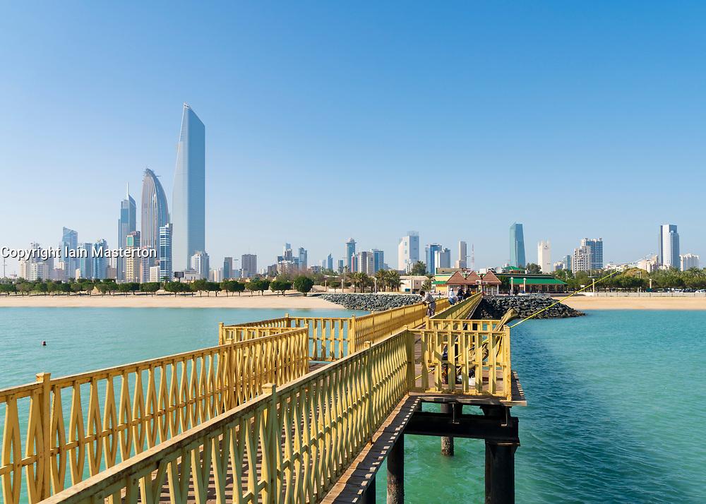 Skyline of modern office towers in downtown CBD from public pier in Kuwait City in Kuwait