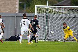 Dumbarton's Bryan Prunty (hidden) scoring their goal.<br /> Dumbarton 1 v 1 Falkirk, Scottish Championship 10/8/2013.<br /> ©Michael Schofield.