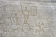 Petroglyph, rock carving, of two warriors with a shield and a man riding a horse. Carved by the ancient Camunni people in the iron age between 1000-1200 BC. Rock no 6, Foppi di Nadro, Riserva Naturale Incisioni Rupestri di Ceto, Cimbergo e Paspardo, Capo di Ponti, Valcamonica (Val Camonica), Lombardy plain, Italy .<br /> <br /> Visit our PREHISTORY PHOTO COLLECTIONS for more   photos  to download or buy as prints https://funkystock.photoshelter.com/gallery-collection/Prehistoric-Neolithic-Sites-Art-Artefacts-Pictures-Photos/C0000tfxw63zrUT4<br /> If you prefer to buy from our ALAMY PHOTO LIBRARY  Collection visit : https://www.alamy.com/portfolio/paul-williams-funkystock/valcamonica-rock-art.html