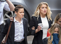 © Licensed to London News Pictures. 27/07/2020. London, UK. American actor AMBER HEARD (R) arrives with Bianca Butti at the High Court in London, where Johnny Depp is in a legal dispute with UK tabloid newspaper The Sun over allegations he assaulted his former wife, Amber Heard. Photo credit: Peter Macdiarmid/LNP