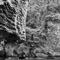 "Greg Sun on stalactite, ""deep water soloing"" without rope, Poda Island, Krabi, Thailand"