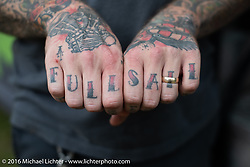 Full Sail knuckle tattoo on Killian Keller of the Vice Grips MC working the Steak Frites truck at the Handbuilt Motorcycle Show. Austin, TX, USA. April 10, 2016.  Photography ©2016 Michael Lichter.