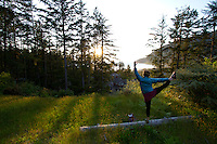 Image of young woman doing yoga in Manzanita, Oregon.