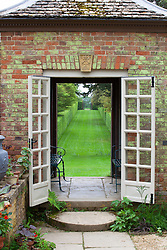 Building framing view at the top of The Long Walk at Hidcote Manor Garden