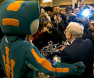 Omaha, Neb 5/6/06 Warren Buffet poses for photos with the Geico Gecko  on the floor at the Berkshire Hathaway annual meeting in the Qwest Center Omaha Saturday Morning..(Chris Machian/Prairie Pixel Group)