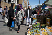 People from various ethnic backgrounds, particularly from the Muslim community around the market on Whitechapel High Street in East London, United Kingdom. This area in the Tower Hamlets is predominantly Muslim with over 50% of Bangladeshi descent. This is known as a very Asian and multi cultural part of Londons East End.