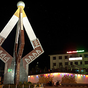 Night shot of the Independence Monument in the middle of Sam Neua (also spelled Samneua, Xamneua and Xam Neua) in northeastern Laos.