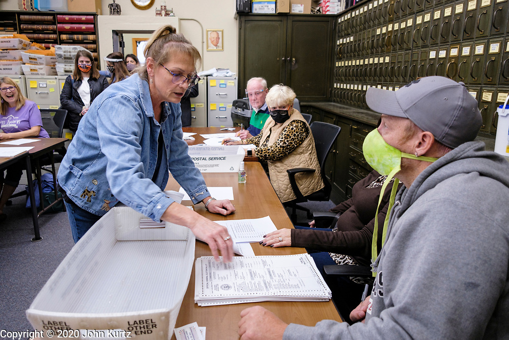 09 NOVEMBER 2020 - NEWTON, IOWA: TINA MULGREW, Deputy Auditor of Elections for Jasper County, distributes ballots that need to be recounted. The Jasper County (Iowa) auditor ordered a manual recount of 561 votes from Clear Creek Poweshiek precinct in Mingo after vote totals were incorrectly transcribed on a spreadsheet. The incorrect vote total tabulation could affect the outcome of the election for Iowa's second congressional district. The incorrect transcription awarded more votes to Republican Congressional candidate Mariannette Miller-Meeks than she actually won and changed the outcome of the race. The corrected totals changed 162 votes and put Rita Hart, the Democratic candidate in the lead by 282 votes. The race is one of the closest races for a Congressional seat.      PHOTO BY JACK KURTZ