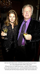 MR & MRS MICHAEL GRADE at a party in London on 17th September 2001.OSJ 270