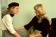 Mother counseling daughter age 58 and 25 on lifes ambitions.  Minneapolis Minnesota USA