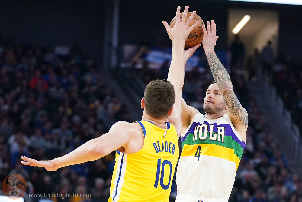 February 23, 2020; San Francisco, California, USA; New Orleans Pelicans guard JJ Redick (4) shoots the basketball against Golden State Warriors center Dragan Bender (10) during the third quarter at Chase Center.