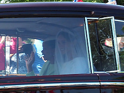 Meghan Markle is seen with her mum Doria in the back of a chauffeur driven vintage Rolls Royce on her way to marry Prince Harry.<br />