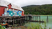 Pier of Haines Packing Company, operating since 1917, at Mile 5.5 Mud Bay Road in Haines, Alaska, USA. At one of oldest cannery sites in SE Alaska, see the seafood processing line through large windows and visit the gift shop. This image was stitched from multiple overlapping photos.