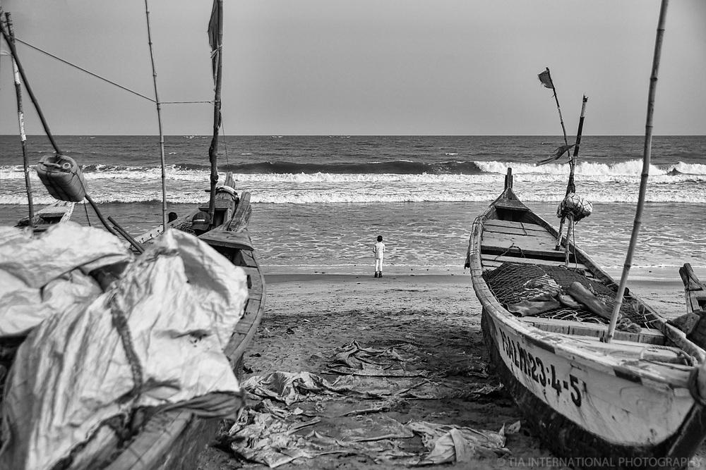 Lone Boy Watching the Ocean, Kokrobite, Ghana (monochrome)
