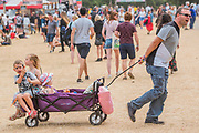 Hot work getting around the arena particularly for dads - The 2018 Latitude Festival, Henham Park. Suffolk 13 July 2018