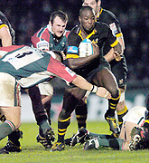 Wycombe. GREAT BRITAIN, 5th December 2004. Heineken Cup Rugby  London Wasps and Leicester Tigers,  Adams Park, ENGLAND, [Mandatory Credit; Peter Spurrier/Intersport-images].<br /> <br /> Wasps centre Ayoola Erinle evades the takles from Julian white [No.3] and George Chuter [behind]