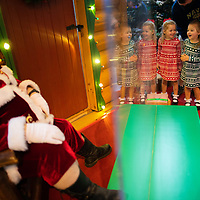 HARRISBURG, PA:  (L-R) Twins Cora <br /> And Julia Fabiszak, 5, react while greeting Santa, who sits behind plexiglass due to the coronavirus (COVID-19) pandemic, at a Bass Pro Shop's Outdoor World in Harrisburg, PA on December 12, 2020. The pandemic has forced difficult decisions about maintaining the holiday tradition of visits to Santa Claus versus safety concerns.  Plexiglass dividers, face shields, and physical distancing are among the precautions for those locations that have proceeded with Santa photo opportunities.  CREDIT:  Mark Makela for The New York Times