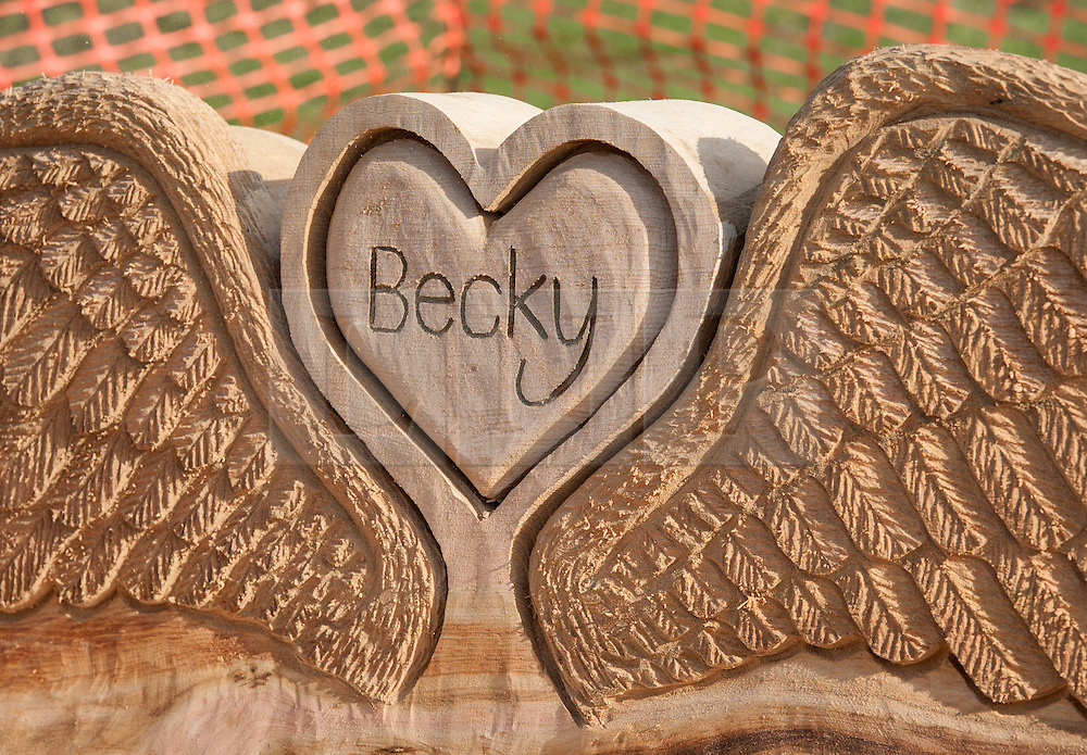 © Licensed to London News Pictures. 16/02/2016. Bristol, UK.  A memorial bench to murdered Bristol schoolgirl Becky Watts is unveiled in Plummers Hill Open Space, just metres from Becky's home in the St George area of Bristol. The sixteen year-old was murdered by her stepbrother Nathan Matthews almost a year ago in 2015. The bench was made by sculptor Andy O'Neill who carved the bench from an oak tree trunk. Photo credit : Simon Chapman/LNP