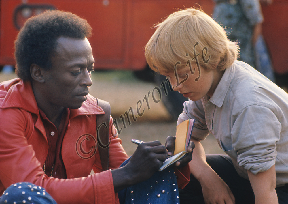 """Miles Davis - autograph.- .When asked on stage what the piece of music he was playing was called, Miles replied """"Call it anything"""". The title stuck and to this day it became the unofficial title of that set at the festival. His performance was mostly improvised, and rather like an abstract and pleasing painting that went on for a very long time. This era was known as Miles'Electric Period."""