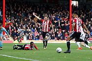 Brentford Midfielder Nico Yennaris (8) scores a goal (score 1-0) during the EFL Sky Bet Championship match between Brentford and Sunderland at Griffin Park, London, England on 21 October 2017. Photo by Andy Walter.
