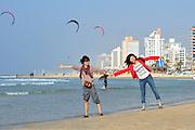 Israel, Tel Aviv two tourists having fun on the beach