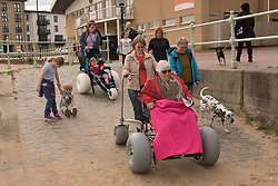 Portobello, Edinburgh's seaside suburb, is awash with Art. Almost everywhere you look there is something to see as the Art Walk Porty community art festival takes place, now extended to run over ten days covering the first two weekends of September. Pictured: One of the artist-led guided walks joined forces with the newly established Portobello Beach Wheelchairs initiative. Artist Jenny Pope led the beach walk on Sunday. <br /> <br /> <br /> © Jon Davey/ EEm