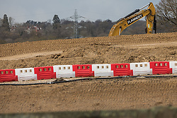 Harefield, UK. 6th April, 2021. Works for the HS2 high-speed rail link are pictured alongside Harvil Road. Thousands of trees have already been felled in the Colne Valley where HS2 works will include the construction of a Colne Valley Viaduct across lakes and waterways and electricity pylon relocation.