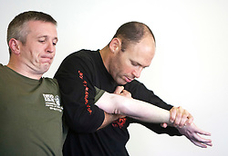 Amnon Darsa takes students through a seminar in Law enforcement restraints on day eight. Train & Travel is a unique ten day program designed for IKMF's instructors, students & guests, interested in combining Krav Maga training with a tour of the holy land..©2011 Michael Schofield. All Rights Reserved.