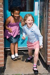 Girls playing in school playground,