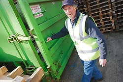 Man with a mild learning disability working as a factory cleaner, shown here with container, helped into employment by the Ready 4 Work team, Nottinghamshire County Council
