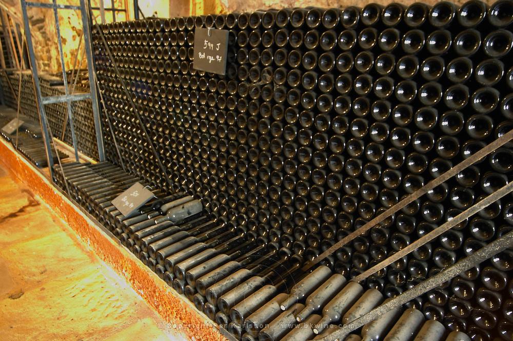 Piles of old bottles aging in the cellar Chateau Vannieres (Vannières) La Cadiere (Cadière) d'Azur Bandol Var Cote d'Azur France