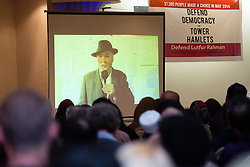 © Licensed to London News Pictures. 01/05/2015. London, UK. George Galloway speaks via a video link at a public meeting held at the Waterlily in Stepney, east London on 30th April 2015. The meeting was ex Mayor of Tower Hamlets, Lutfur Rahman's first public appearance after being found guilty of electoral fraud last week and called for attendees to donate money to a legal fund to facilitate an appeal against the High Court ruling. Photo credit : Vickie Flores/LNP