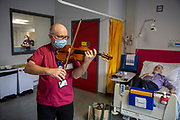 Mcc0098692 . Daily Telegraph<br /> <br /> DT News<br /> <br /> Dr Maxton Pitcher, a Consultant Gastroenterologist has been playing his violin for the benefit of patients and hospital staff since the pandemic began . <br /> <br /> Northwick Park Hospital <br /> <br /> London 2 February 2021
