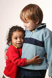 Young boys hugging,