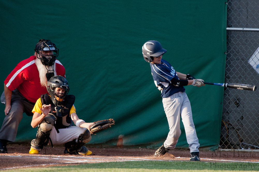 Paramus' Brandon Smith fouls off the ball during an at bat in the first inning at the Little League State Tournament finals between Paramus and Erial held in Williamstown Tuesday night.