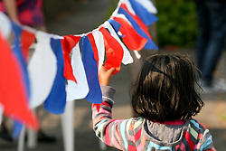 Cambridge, UK  29/04/2011. The Royal Wedding of HRH Prince William to Kate Middleton. A child with bunting on a  Street Party in Cambridge city centre. Photo credit should read Jason Patel/LNP. Please see special instructions. © under license to London News Pictures