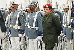 President Hugo Chavez  participates in a military parade at the Fuerte Tiuna military base