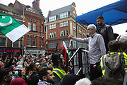 Thousands turn out in protest against the increasing use of military force by Israel and in support of Gaza on the 15th of May 2021, London, United Kingdom. Jeremy Corbyn, former leader of the Labour Party greets the crowd. The demonstration outside the Israeli embassy in Kensington High Street.The escalating war between Israel and Hamas in Gaza is increasingly costing lives and the up to 100.000 protesters were calling for Israel to stop bombing Gaza and for a free Palestine.