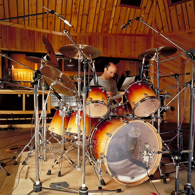 """Kenny Aronoff, world renowed drummer for his """"back-beat"""", recording an album """"Burning for Buddy, a Tribute to Buddy Rich"""" at the Power Station, New York City, NY. The album was released in 1994. Musicians like John Mellencamp, The Smashing Pumpkins, Bob Seger, John Fogerty, Melissa Etheridge, Jon Bon Jovi, and Elton John, to name only a few, seek out Kenny's talent on the drums for their albums. The Aronoff Percussion Scholarship is awarded annually to a percussion student enrolled at Indiana University where he used to be an Associate Professor of Percussion."""