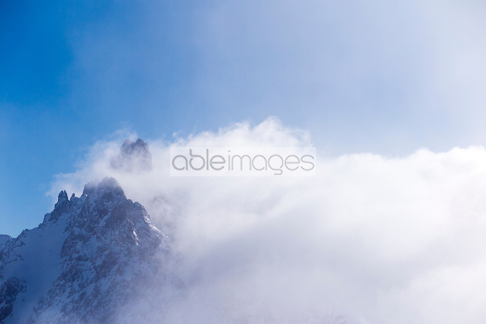 French Alps. Les Trois Vallées, Savoie, France. Mountain Peaks surrounded by Clouds