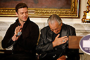 """April 9, 2013 - Justin Timberlake applauds as harmonica great Charlie Musselwhite takes a humble bow when he was introduced at a Memphis music workshop in the State Dining Room at the White House on Tuesday. The workshop event: """"Soulsville, USA: The History of Memphis Soul""""  was attended by students from all over the country, including two from Stax Academy in Memphis.  It was hosted by Michelle Obama."""