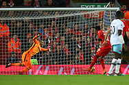 Divock Origi of Liverpool shoots and scores his teams 2nd goal. Premier League match, Liverpool v West Ham Utd at the Anfield stadium in Liverpool, Merseyside on Sunday 11th December 2016.<br /> pic by Chris Stading, Andrew Orchard sports photography.