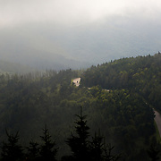 A vehicle can be seen on the road below atop Mt. Mitchell, the highest point east of the Mississippi.