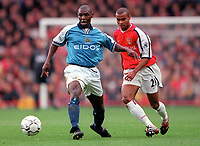 Ashley Cole (Arsenal) Shaun Goater  (Manchester City). Arsenal v Manchester City, F.A.Carling Premiership, 28/10/2000. Credit Colorsport / Stuart MacFarlane.