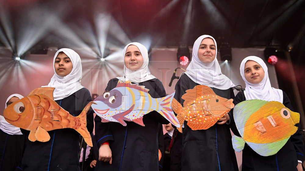 © Licensed to London News Pictures. 23/06/2018. LONDON, UK.  Girls from the Al-Sadiq Al-Sahra Schools Choir, an all Muslim choir who performed at the Grenfell Memorial at St Paul's Cathedral, on stage as people celebrate the EID Festival in Trafalgar Square, an event hosted by The Mayor of London.  The Mayor's festival takes place in the square one week after the end of Ramadan and includes a variety of stage performances and cultural activities.  Photo credit: Stephen Chung/LNP