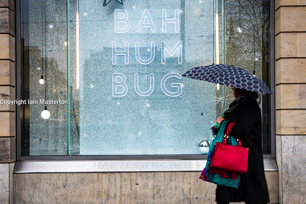 Edinburgh, Scotland, UK. 20 November 2020. Shop window displays with posters offering large discounted sale prices on Black Friday in Edinburgh. Pictured; Harvey Nichols with a low key and sober window display. Iain Masterton/Alamy Live News